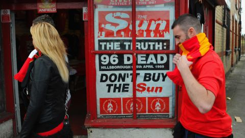 """A poster protesting about the way in which Liverpool fans were blamed for the Hillsborough disaster is displayed outside Anfield in 2012. The club's supporters boycotted """"The Sun"""" newspaper due to its coverage of the deaths."""