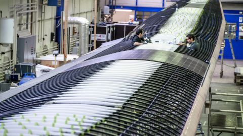 The top surface of the Solar Impulse 2's wings is covered with 17,000 solar cells that supply four electric motors with renewable energy. Its batteries can store enough solar daytime energy to keep the plane moving throughout the night.