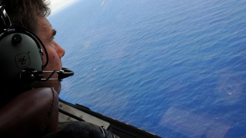 IN FLIGHT - APRIL 11: Co-pilot and Squadron Leader Brett McKenzie of the Royal New Zealand Airforce (RNZAF) P-3K2-Orion aircraft, helps to look for objects during the search for missing Malaysia Airlines flight MH370 in flight over the Indian Ocean on April 13, 2014 off the coast of Perth, Australia. Search and rescue officials in Australia are confident they know the approximate position of the black box recorders from missing Malaysia Airlines Flight MH370, Australian Prime Minister Tony Abbott said on Friday. At the same time, however, the head of the agency coordinating the search said that the latest 'ping' signal, which was captured by a listening device buoy on Thursday, was not related to the plane. (Photo by Greg Wood - Pool/Getty Images)