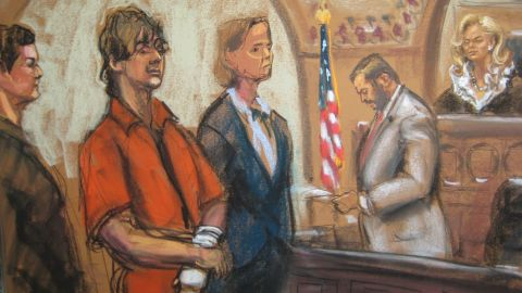 Tsarnaev stands in court, flanked by his lawyers, in this sketch from July 2013.