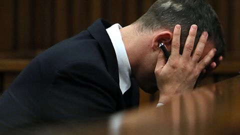 South African sprinter Oscar Pistorius reacts during his trial at the North Gauteng High Court in Pretoria on April 15, 2014.