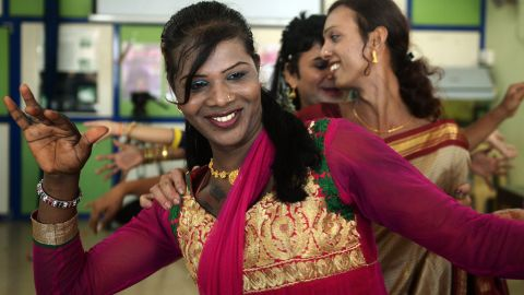 An Indian transgender resident dances with others at an event to celebrate a Supreme Court judgement in Mumbai on April 15, 2014. India's highest court ruled that a person can be legally recognised as gender-neutral, a landmark judgement that raises hopes of an end to discrimination against several million transgenders and eunuchs.