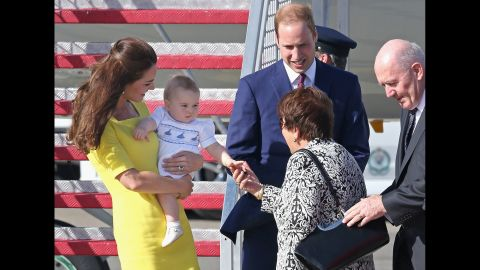 George shakes hands with Lynne Cosgrove, the wife of Australia's governor-general, on the tarmac of Sydney Airport on April 16.