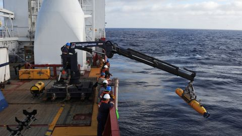 Operators aboard the Australian ship Ocean Shield move Bluefin-21, the U.S. Navy's autonomous underwater vehicle, into position to search for the jet on April 14, 2014.
