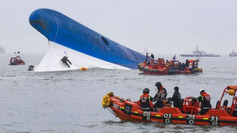South Korean Coast Guard members search for survivors on April 16.