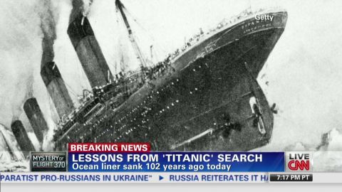 The Titanic tipping into the waters