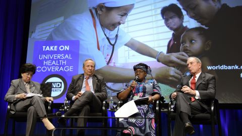 """Bloomberg, right, participates in a """"Toward Universal Health Coverage for 2030"""" seminar in April during the IMF/World Bank's Spring Meetings in Washington."""