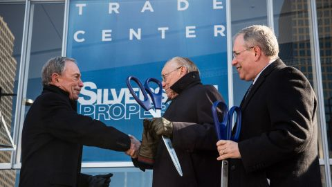 Bloomberg shakes hands with Larry Silverstein, the developer who held the lease to the World Trade Center buildings in 2001, after cutting the ribbon at the opening ceremony of Four World Trade Center. It's the first tower to open at the original site of the World Trade Center.
