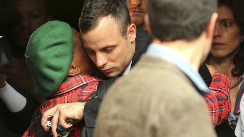Pistorius gets a hug from a woman as he leaves court in Pretoria on Wednesday, April 16.
