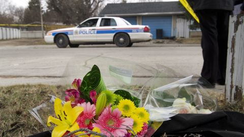 A makeshift memorial is left at police tape line near the scene of the multiple fatal stabbing.