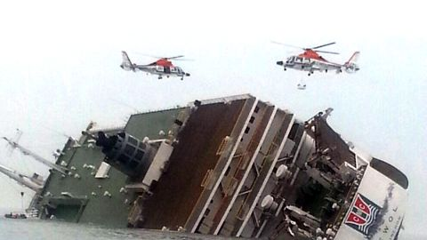 Helicopters hover over the ferry as rescue operations continue April 16.
