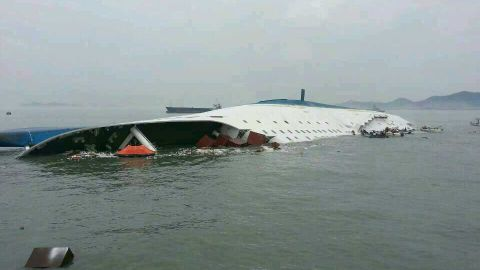 Caption:JINDO-GUN, SOUTH KOREA - APRIL 16: In this handout image provided by the Republic of Korea Coast Guard, a passenger ferry sinks off the coast of Jindo Island on April 16, 2014 in Jindo-gun, South Korea. The ferry identified as the Sewol was carrying about 470 passengers, including students and teachers, traveling to Jeju island. (Photo by The Republic of Korea Coast Guard via Getty Images)