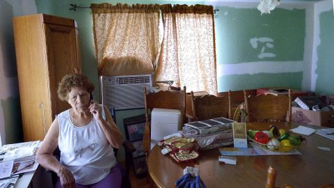 Eleanor Castro sits in her home in West, Texas, on Tuesday, April 1. Her property was damaged in the fertilizer plant explosion last year.