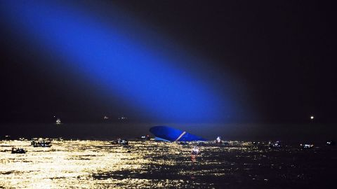 A blue search light cast by a South Korean Coast Guard helicopter illuminates the ferry on April 17 as search and rescue operations continue.