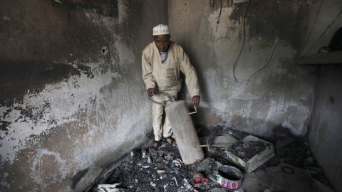 """An official displays burned equipment inside a prison in Bauchi, Nigeria, on September 9, 2010, after the prison was attacked by suspected members of Boko Haram two days earlier. About <a href=""""http://www.cnn.com/2010/WORLD/africa/09/08/nigeria.prison.break/index.html"""">720 inmates escaped</a> during the prison break, and police suspect the prison was attacked because it was holding 80 members of the sect."""