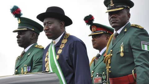 """Nigerian President Goodluck Jonathan, second from left, stands on the back of a vehicle after being <a href=""""http://www.cnn.com/2011/WORLD/africa/05/29/nigeria.president.inauguration/index.html"""">sworn-in as President </a>during a ceremony in the capital of Abuja on May 29, 2011. In December 2011, Jonathan declared a <a href=""""http://www.cnn.com/2011/12/31/world/africa/nigeria-state-of-emergency/"""">state of emergency</a> in parts of the country afflicted by violence from Boko Haram."""