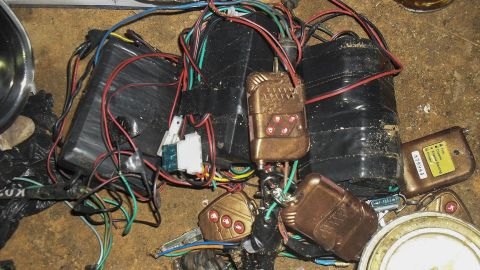 """A photograph made available by the Nigerian army on August 13, 2013, shows improvised explosive devices, bomb-making materials and detonators seized from a Boko Haram hideout. Gunmen attacked a <a href=""""http://edition.cnn.com/2013/08/13/world/africa/nigeria-attacks/"""">mosque in Nigeria with automatic weapons</a> on August 11, 2013, killing at least 44 people."""