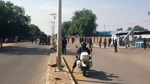 """Soldiers stand outside the 79 Composite Group Air Force base that was attacked earlier in Maiduguri on December 2, 2013.<a href=""""http://edition.cnn.com/2013/12/02/world/africa/boko-haram-attack/""""> Hundreds of Boko Haram militants attacked</a> an Air Force base and a military checkpoint, according to government officials."""