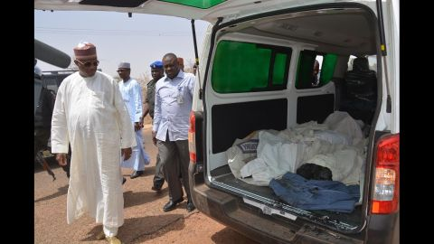 """Yobe state Gov. Ibrahim Gaidam, left, looks at the bodies of students inside an ambulance outside a mosque in Damaturu. At least 29 students died in an <a href=""""http://edition.cnn.com/2014/02/25/world/africa/nigeria-school-attack/"""">attack on a federal college </a>in Buni Yadi, near the capital of Yobe state, Nigeria's military said on February 26, 2014. Authorities suspect Boko Haram carried out the assault in which several buildings were also torched."""