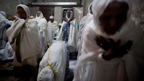 Ethiopian Orthodox women pray at the Deir El Sultan monastery during the Washing of the Feet ceremony outside the Church of the Holy Sepulchre in Jerusalem on April 17. The church is traditionally believed by many to be the site of the crucifixion and burial of Jesus Christ.
