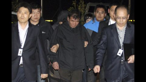 Lee Joon Suk, the captain of the Sewol, is escorted to the court that issued his arrest warrant Friday, April 18, in Mokpo, South Korea.