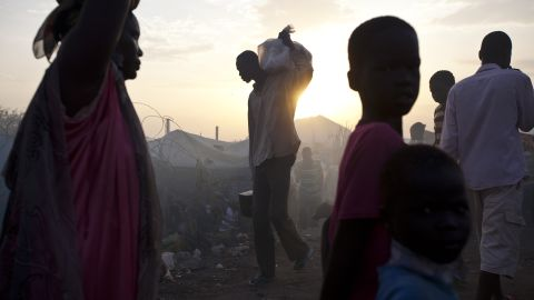 A man carries a bag on his shoulder at a camp in Malakal, South Sudan, on Wednesday, March 19.