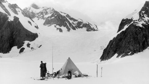 Mountaineers are seen preparing to leave their camp during one of Eric Shipton's early expeditions on Everest in the 1930s. While Shipton never made it to the summit, his exploration of the mountain paved the way for others.