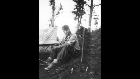 Edmund Hillary sits at base camp in May 1953 before heading out on what would become the first successful ascent to the top of the world.