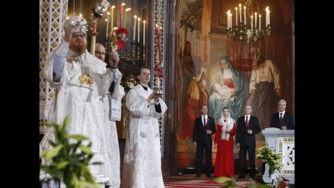 Russian Prime Minister Dmitry Medvedev, from left, his wife, Svetlana, Russian President Vladimir Putin and Moscow Mayor Sergey Sobyanin attend the Orthodox Easter service at the Christ the Savior Cathedral in Moscow.