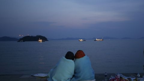Relatives of passengers look out at the sea from Jindo on April 20.