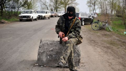 An armed pro-Russian militant stands guard at the check-point on April 20.