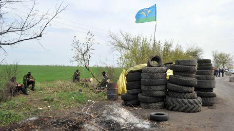 Armed pro-Russian militants stand guard at a roadblock near Slovyansk on April 20.