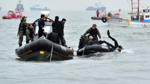 A diver enters the water on April 19 at the site of the sunken Sewol ferry near Jindo in South Korea. Dive teams have been working continuously to try and access the vessel. Visibility, poor weather and strong currents have hampered the search and rescue operation.