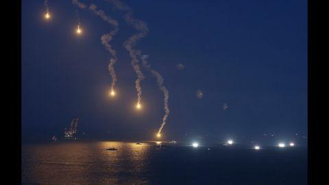 Search operations continue as flares illuminate the scene near Jindo on Sunday, April 20.