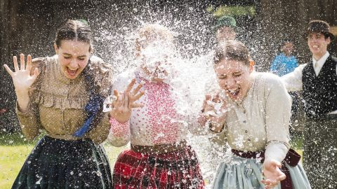 Women in traditional costumes are sprayed with water by men as members of the Marghareta Dance Group perform Easter folk traditions of the region in the Museum Village in Nyiregyhaza, 227 kms northeast of Budapest, Hungary, Monday, April 21, 2014. According to a hundred years old tradition of Hungarian villages, young men pour water on young women who in exchange present their sprinklers with beautifully coloured eggs on Easter Monday. (AP Photo/MTI/ Attila Balazs)