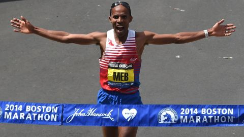 Meb Keflezighi of the US, crosses the finish line to win the Men's Elite division of the 118th Boston Marathon in Boston, Massachusetts April 21, 2014 .  AFP PHOTO / Timothy A. CLARY        (Photo credit should read TIMOTHY A. CLARY/AFP/Getty Images)