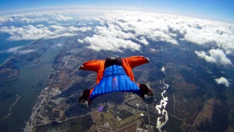 """<em>Is it a bird? Is it a plane? Actually, it's a bit of both. </em><br /> <br />Wingsuits fly for the same reason jets take off and eagles soar.<br /> <br />The suits turn the human body into an """"airfoil"""" -- a curved wing that produces lift by allowing air to flow faster over the wing than under it.<br /> <br />Skydiving photographer <a href=""""http://www.theharryparker.com/"""" target=""""_blank"""" target=""""_blank"""">Harry Parker</a> caught these incredible images of wingsuiter Rip Cord in action over Sebastian, Florida. And we asked skydiving pioneer Tony Uragallo, founder of <a href=""""http://www.tonywingsuits.com/index.html"""" target=""""_blank"""" target=""""_blank"""">TonySuits</a>, to tell us more about how today's wingsuits fly.<br /><br /><em>[All photos: Courtesy </em><a href=""""http://www.theharryparker.com/"""" target=""""_blank"""" target=""""_blank""""><em>Harry Parker Photography</em></a><em>]</em>"""