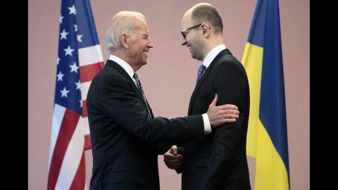 U.S. Vice President Joe Biden, left, talks with Ukrainian Prime Minister Arseniy Yatsenyuk during a meeting in Kiev on April 22.