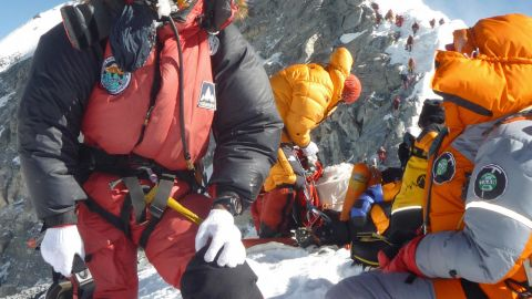 Nepalese mountaineer Pemba Dorje Sherpa (L) pauses at the Hillary Step while pushing for the summit of Everest on May 19, 2009, after climbing from the south face of Nepal.
