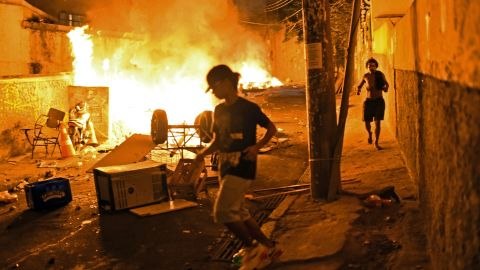 Residents run for cover during violent clashes between protesters and police.