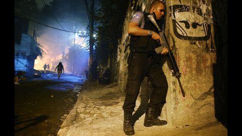 A police officer patrols a street just blocks from Copacabana Beach.