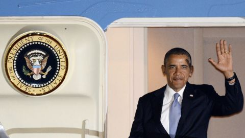 Obama steps from Air Force One after landing in Tokyo on April 23.