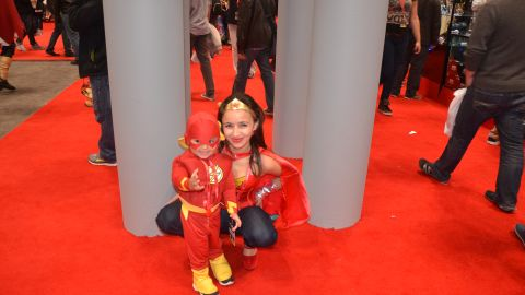 """Kids can often be seen dressing like their adult cosplaying counterparts at conventions like <a href=""""http://ireport.cnn.com/docs/DOC-1047486"""">New York Comic Con</a>. Here's Wonder Woman posing with a pint-size Flash at last year's convention in the Big Apple."""