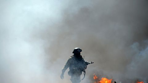 A Ukrainian special forces member takes position in Slovyansk.