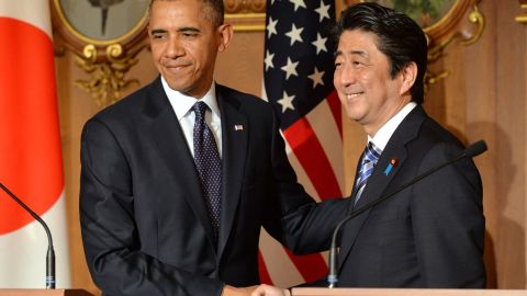 US President Barack Obama (L) shakes hands with Japanese Prime Minister Shinzo Abe following a bilateral press conference at the Akasaka Palace in Tokyo on April 24, 2014.