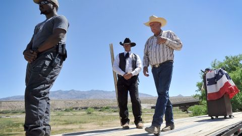 Rancher Cliven Bundy, right, leaves the podium with body guards after a news conference near his ranch in Bunkerville, Nevada, on April 24.  Bundy and the Bureau of Land Management have been locked in a dispute for a couple of decades over grazing rights on public lands.