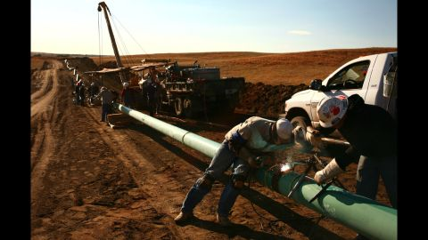 A crew constructs a 10-inch gas pipeline outside Watford City, North Dakota in October 2011. In fracking, water, sand and chemicals are injected under high pressure into a gas well.