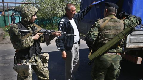 Pro-Russia armed militants inspect a truck near Slovyansk on Friday, April 25. Russian Foreign Minister Sergey Lavrov has accused the West of plotting to control Ukraine, and he said the pro-Russia insurgents in the southeast would lay down their arms only if the Ukrainian government clears out the Maidan protest camp in the capital, Kiev.