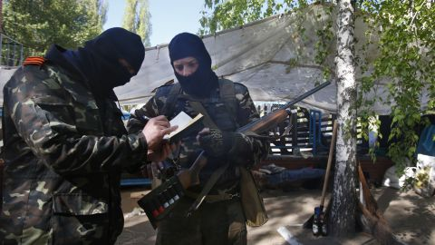 Pro-Russia militants keep records of their duty in Slovyansk on April 25.