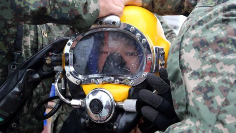 Divers search for people in the waters near Jindo on April 26.
